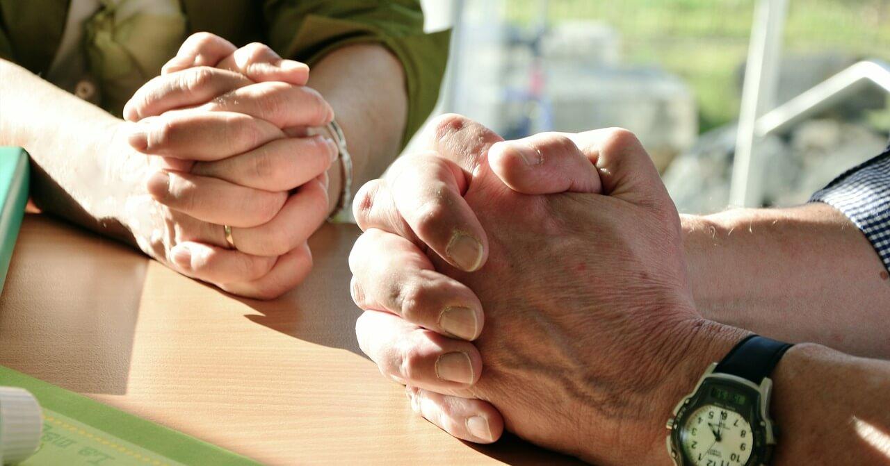Image of praying hands.