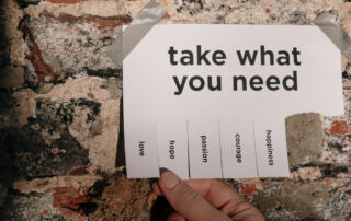 "Image of a paper with ""Take what you need"" listed and tabs for love, hope, courage, etc."