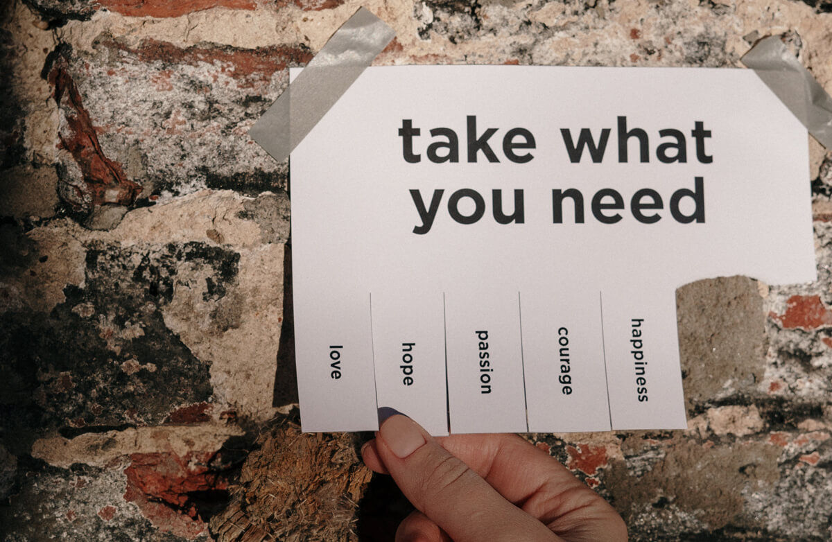 """Image of a paper with """"Take what you need"""" listed and tabs for love, hope, courage, etc."""